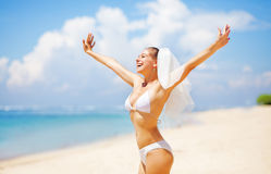 Happy bride on a beach Royalty Free Stock Image