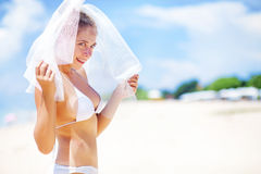 Happy bride on a beach Royalty Free Stock Photography