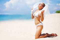 Happy bride on a beach Stock Image