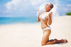 Happy bride on a beach Stock Image