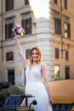 Happy bride in beautiful carriage on wedding walk.  Royalty Free Stock Photography