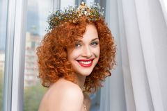 Woman with crown fashion model person girl looking at you camera smiling royalty free stock images