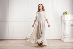 Happy bride in beautiful silk dress posing in studio. Stock Images