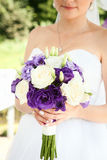 Happy bride with beautiful wedding bouquet Royalty Free Stock Images