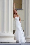 Happy bride behind a column 1 Stock Images