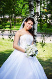 Happy bride at the birches Royalty Free Stock Image