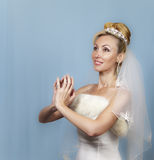 The happy bride on a blue background Royalty Free Stock Photography