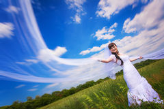 Happy bride on the blue sky background Royalty Free Stock Photography