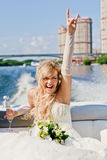 Happy bride on a boat floats Stock Photos