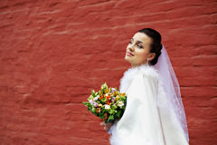 Happy bride with bouquet Stock Image