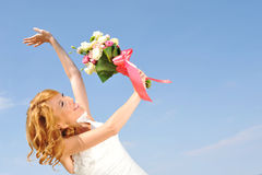 Happy bride with bouquet Stock Photo