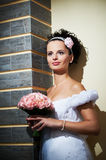 Happy bride with bouquet of flowers Stock Photos