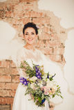Happy bride with a bouquet Royalty Free Stock Image