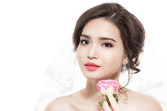 Happy bride with a bouquet of roses. Isolated on white backgroun Stock Photo