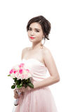 Happy bride with a bouquet of roses. Isolated on white backgroun Stock Photos