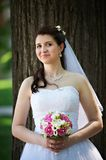 Happy bride with bouquet in wedding walk Stock Images