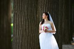 Happy bride with bouquet in wedding walk Royalty Free Stock Photography