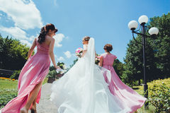 Happy Bride with bridesmaids in the park on the wedding day Royalty Free Stock Photography