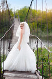 Happy bride on the bridge Stock Images