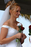 Happy bride during ceremony. A bride smiling as she is getting married in an outdoor ceremony Stock Photos