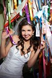 Happy bride and colorful ribbons Stock Photo
