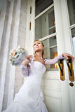 Happy Bride at entrance to palace Stock Photo