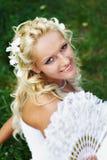 Happy bride with fan Royalty Free Stock Photos