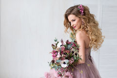 Happy Bride. Fashion. Young Happy Bride With Flower Bouquet in pink dress. beauty and fashion royalty free stock image