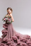 Happy Bride With Flower Bouquet in pink dress. royalty free stock images