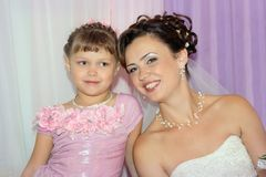 Happy bride with flower girl Stock Photos