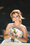 Happy Bride with Flowers. At table Royalty Free Stock Photos