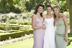 Happy Bride With Friends In Garden stock photography