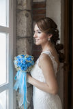Happy bride in front of window Royalty Free Stock Photo