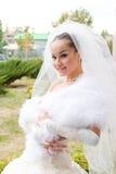 Happy bride in a fur cape Stock Image