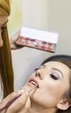 Happy bride getting her makeup ready Royalty Free Stock Photo