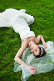 Happy bride are on grass Stock Images