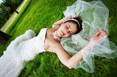 Happy bride are on grass Royalty Free Stock Image