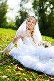 Happy bride on the grass Stock Photos