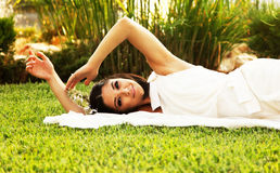 Happy bride on the grass Royalty Free Stock Images