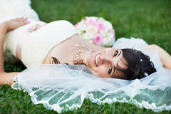 Happy bride on grass Stock Photo