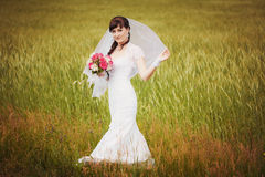 Happy bride in the green field Royalty Free Stock Photo