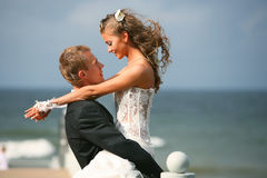 Happy bride and groom. On their wedding day royalty free stock photo