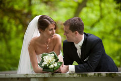 Happy bride and groom. Beautiful bride and groom looking very happy on their big day Stock Image