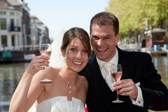 Happy bride and groom. Beautiful young couple having a toast to their wedding Royalty Free Stock Image