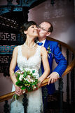 Happy bride and groom on ancient stair royalty free stock photo