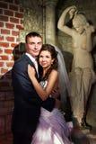 Happy bride and groom in antique interior Royalty Free Stock Image