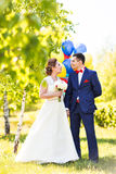 Happy bride and groom with  balloons Royalty Free Stock Photos