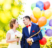Happy bride and groom with  balloons Royalty Free Stock Image