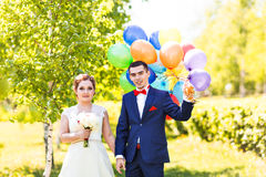 Happy bride and groom with  balloons Stock Photo