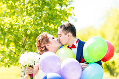 Happy bride and groom with  balloons Royalty Free Stock Photo